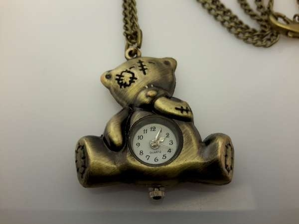 Ketting met klokje, bronskleur, lappenbeertje