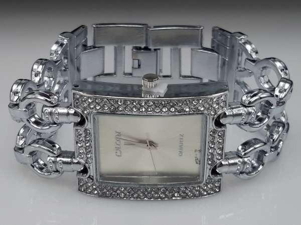 Dameshorloge, zilverkleur, dubbele schakelband, rechthoekige klok, strass