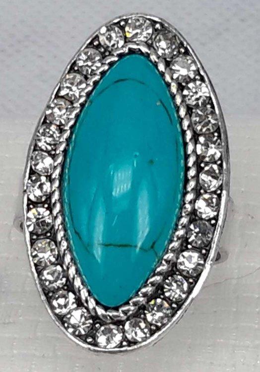 Zilverkleurig ring met midden Howliet edelsteen en strass rand.
