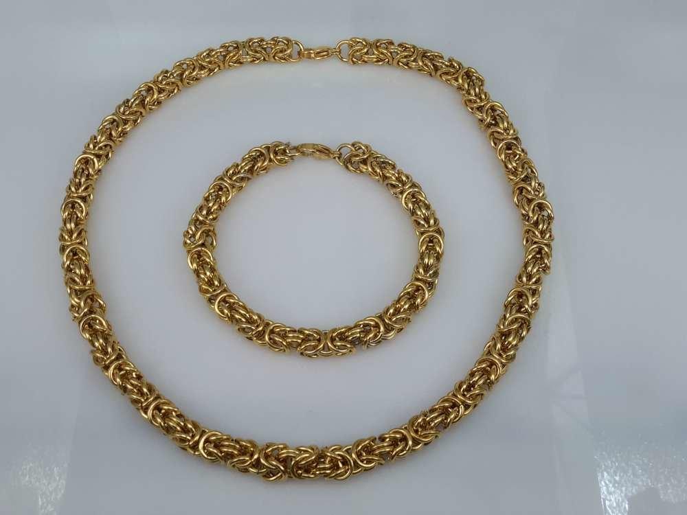 Edelstaal goudkleurig Armband 24 cm, motief Draak rond dubbel schakel.