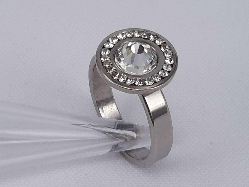 Edelstaal Ringen zilverkleurig rond met 7mm zirkonia en rond omheen strass steentjes, doos 36 st