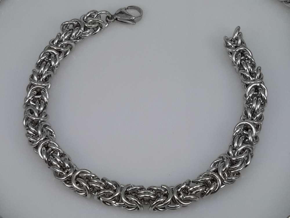 Edelstaal zilverkleurig Armband 24 cm, motief Draak rond dubbel schakel.