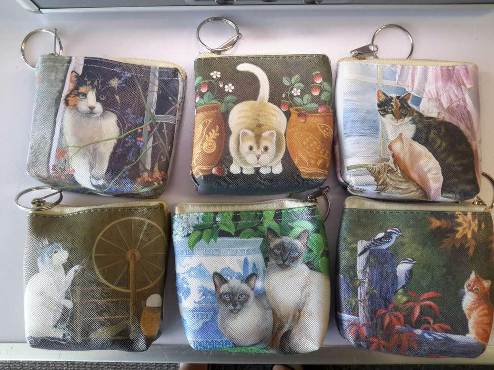 Portemonnee met 6 verschillende katten print.