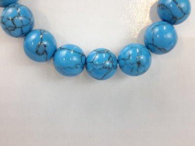 Armband Turkoois blauw 17 kralen van 12 mm