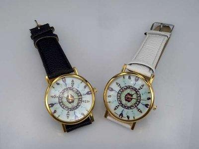 Horloge, goudkleurig, krokodillen PU leren band, veertjes op wijzerplaat, zwart en wit