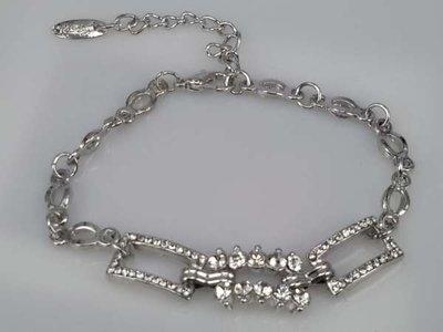 Armband, zilverkleur 3 schakels met kristal en strass