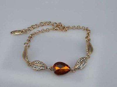 Armband, goudkleur met Topaz, zirkonia en strass