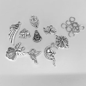 10 x  Tibetaans zilver verschillende bedel met ringetjes,